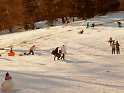 People sledding in Central park New York.