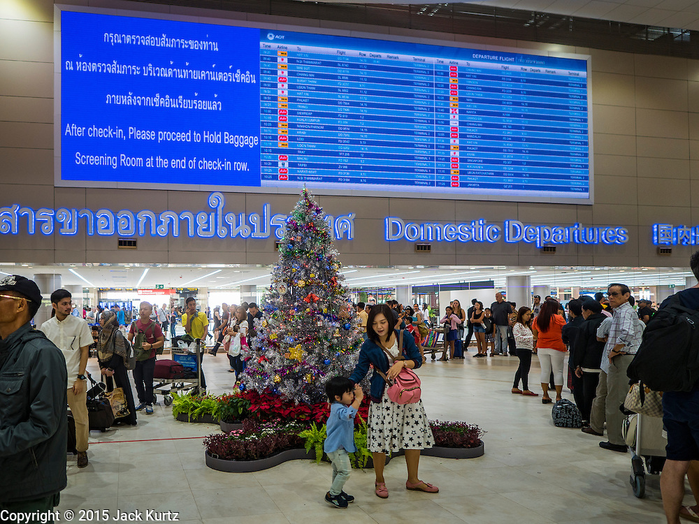 "24 DECEMBER 2015 - BANGKOK, THAILAND:  Passengers in the new domestic terminal at Don Muang (also spelled Don Mueang) International Airport. The new terminal had its ""soft"" opening Dec. 24. Don Muang is the airport used by low cost airlines serving Bangkok and is now the largest airport in the world for low cost carriers. In 2014, more than 21million passengers used Don Muang. Don Muang International Airport is the oldest airport in Asia and one of the oldest airports in the world. It started functioning as an airfield in 1914.    PHOTO BY JACK KURTZ"