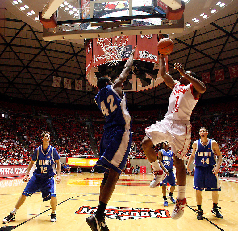 Johnnie Bryant of the University of Utah goes up for a shotk over Anwar Johnson of Air Force during game at the Huntsman Center in Salt Lake City, Utah Saturday, Jan. 5, 2007.  August Miller/ Deseret Morning News .