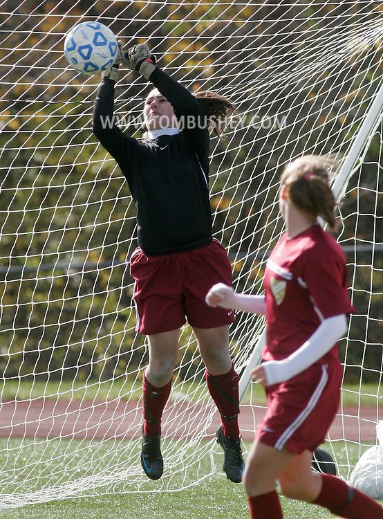 Yorktown Heights, NY -Arlington's goalie punches the ball away in the Section 1 Class AA girls' soccer championship game against John Jay at Yorktown High School on Nov. 2, 2008. ©Tom Bushey / The Image Works