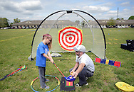 Brianna Brown (left), 9, of Tabernacle, New Jersey is taught some golf basics by Steve Platt of Golf Performance Institute in Mt. Laurel during YMCA 'Healthy Kids Day'  Saturday April 30, 2016 in Mt. Laurel, New Jersey.  (Photo by William Thomas Cain)