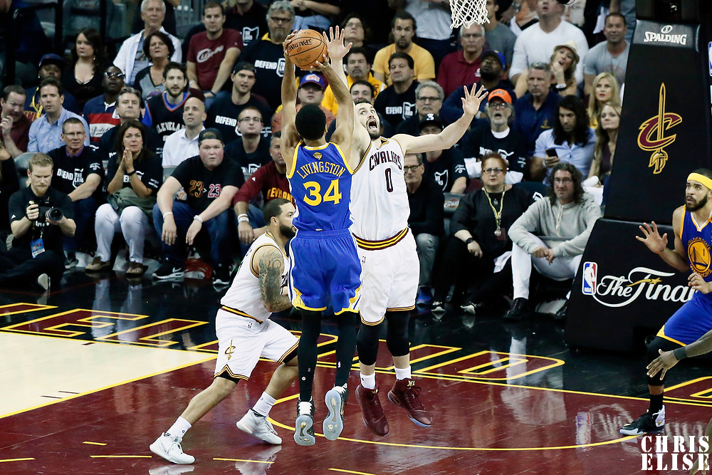 09 June 2017: Golden State Warriors guard Shaun Livingston (34) takes a jump shot over Cleveland Cavaliers forward Kevin Love (0) during the Cleveland Cavaliers 137-11 victory over the Golden State Warriors, in game 4 of the 2017 NBA Finals, at  the Quicken Loans Arena, Cleveland, Ohio, USA.