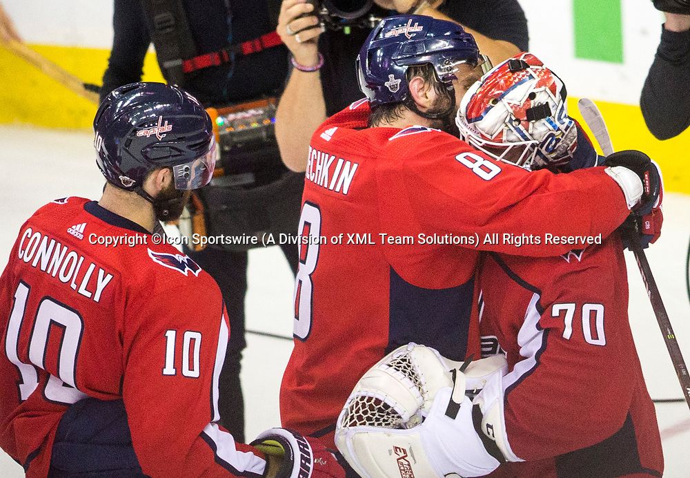 WASHINGTON, DC - MAY 21: A hug from captain Alex Ovechkin (8) for Washington Capitals goaltender Braden Holtby (70) after his shutout of the Lightning at the end of game 6 of the NHL Eastern Conference  Finals between the Washington Capitals and the Tampa Bay Lightning, on May 21, 2018, at Capital One Arena, in Washington D.C. The Caps defeated the Lightning 3-0<br /> (Photo by Tony Quinn/Icon Sportswire)