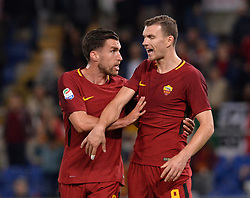 April 18, 2018 - Rome, Italy - Kevin Strootman, Edin Dzeko during the Italian Serie A football match between A.S. Roma and AC Genoa at the Olympic Stadium in Rome, on april 18, 2018. (Credit Image: © Silvia Lore/NurPhoto via ZUMA Press)