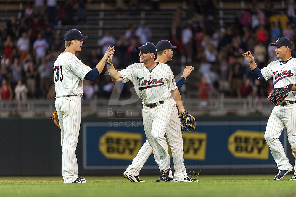 Clete Thomas #11 and Justin Morneau #33 of the Minnesota Twins celebrate after the Twins defeated the Chicago White Sox on June 19, 2013 at Target Field in Minneapolis, Minnesota.  The Twins defeated the White Sox 7 to 4.  Photo: Ben Krause