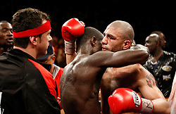 June 13, 2009; New York, NY, USA;  WBO Welterweight Champion Miguel Cotto and challenger Joshua Clottey hug after their 12 round bout at Madison Square Garden. Mandatory Credit: Ed Mulholland