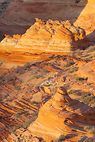 Setting sun illuminating cross-bedding in sandstone buttes of South Coyote Buttes, Vermilion Cliffs Wilderness Utah
