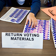 "Election worker Allison Devitt hands out ""I Voted"" stickers at the University of California, San Diego on Tuesday."