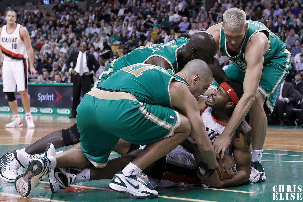 09 March 2012: Portland Trailblazers center Craig Smith (83) vies for the ball with Boston Celtics small forward Sasha Pavlovic (11), Boston Celtics power forward Kevin Garnett (5) and Boston Celtics center Greg Stiemsma (54) during the Boston Celtics 104-86 victory over the Portland Trail Blazers at the TD Banknorth Garden, Boston, Massachusetts, USA.