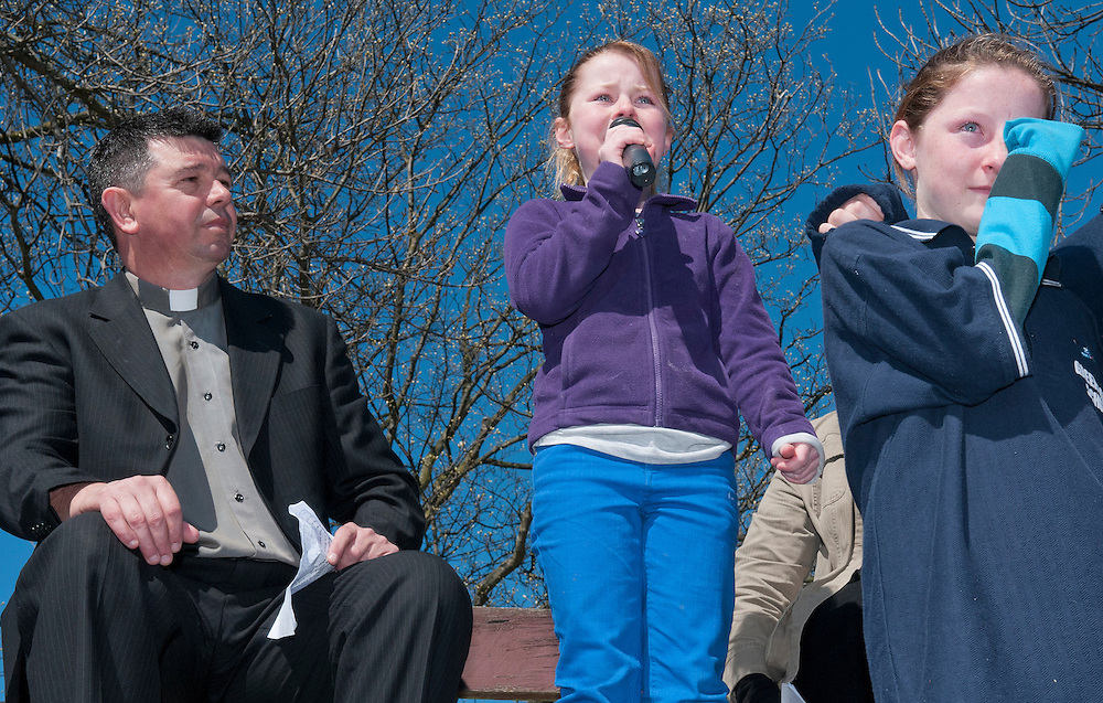 School friends are overcome as Aleisha Mehlhopt of Greenpark School speaks at the rally for protesters against Government proposals to close and merge some schools in Christchurch, held in Hagley Park South, Christchurch, New Zealand,  Saturday 22 September, 2012. Credit: SNPA /  David Alexander.