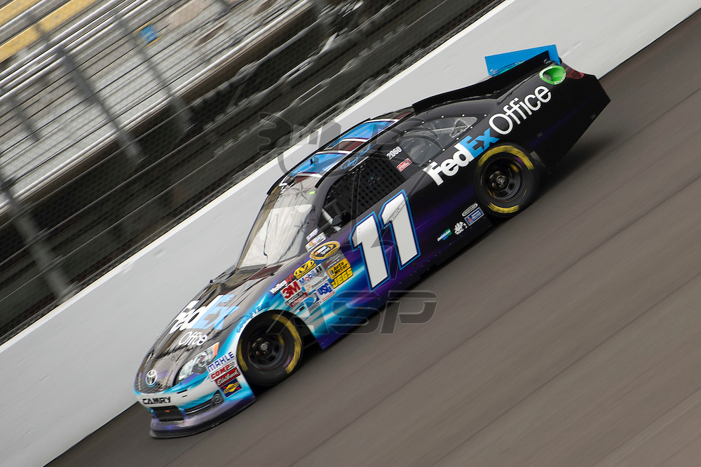 Brooklyn, MI - JUN 16, 2012: Denny Hamlin driving his race car during a practice session for the Quicken Loans 400 race at the Michigan International Speedway in Brooklyn, MI.