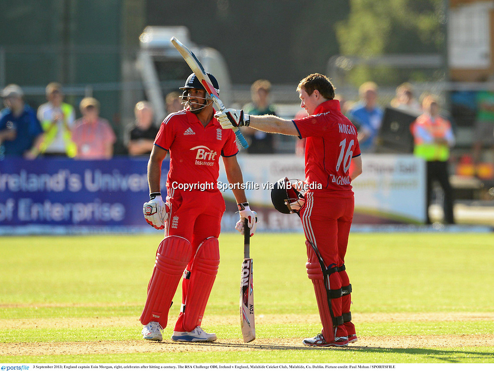3 September 2013; England captain Eoin Morgan, right, celebrates after hitting a century. The RSA Challenge ODI, Ireland v England, Malahide Cricket Club, Malahide, Co. Dublin. Picture credit: Paul Mohan / SPORTSFILE