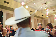 Guests talk about wine, crabs, and the auction items during the Milpitas Chamber of Commerce Crab Feed at Napredak Hall in San Jose, California, on March 6, 2015. (Stan Olszewski/SOSKIphoto)