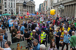London, June 20th 2015. Thousands of people converge on the streets of London to join the People's Assembly Against Austerity's march from the Bank of England to Parliament Square. PICTURED:  The crowd of thousands clogs the streets outside the Bank of England as it prepares to march towards Westminster. //Contact for image Licencing: Paul@pauldaveycreative.co.uk Tel:07966016296