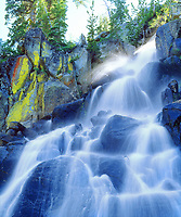 USA, California, Sierra Nevada Mountains.  A waterfall and Lichen coveren Rocks . Credit as: Christopher Talbot Frank