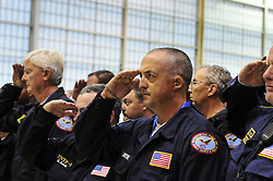 FEMA Urban Search & Rescue team members from Maryland, Nevada, Pennsylvania, Tennessee, Virginia and Washington pause in reflection to remember the victims of the attacks in the United States on Sept. 11, 2001 on Monday, Sept. 11, 2017 at Robins Air Force Base in Warner Robins, Georgia. Members of the Urban Search & Rescue teams are staged at the base for response to Hurricane Irma. Photo By | CHRIS POST FEMA PA TF-1