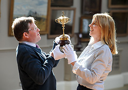 Hamish Wilson and Amanda Doves from Bonham's with the replica Ryder Cup presented to Sergio Garcia in 2001,  which is expected to fetch up to &pound;8000 GBP in Bonham's sporting goods sale.<br /> <br /> &copy; Dave Johnston/ EEm