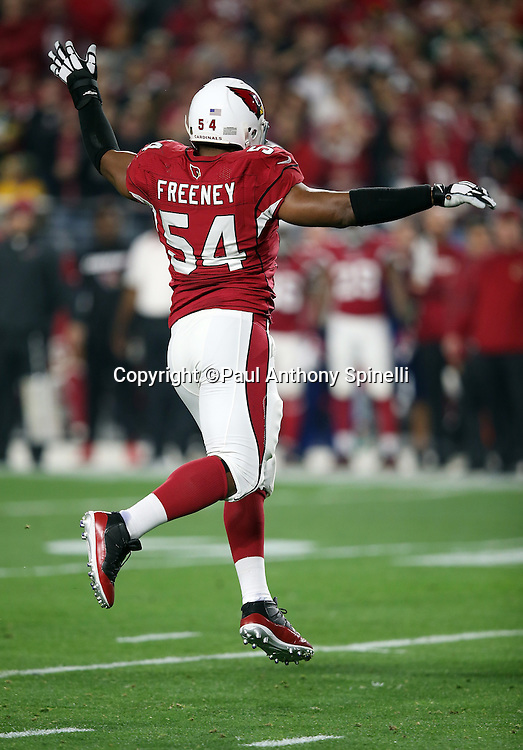 Arizona Cardinals inside linebacker Dwight Freeney (54) leaps as he tries to block a pass during the NFL NFC Divisional round playoff football game against the Green Bay Packers on Saturday, Jan. 16, 2016 in Glendale, Ariz. The Cardinals won the game in overtime 26-20. (©Paul Anthony Spinelli)