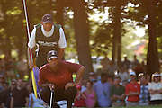 Jul 31, 2005; Grand Blanc, MI, USA; Tiger and his caddie check the line on what would be an eagle putt on the sixteenth hole during final round play at the 2005 Buick Open at the Warwick Hills Golf and Country Club. Copyright © 2005 Kevin Johnston