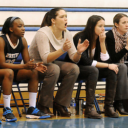 Staff photos by Tom Kelly IV<br /> Rustin head girls basketball coach Leah Kim (center) on the bench during the West Chester Rustin at Great Valley girls basketball game on Thursday night, January 9, 2014.
