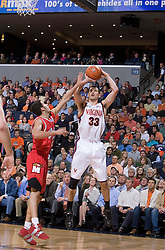 Virginia's Jason Cain (33) shoots a jump shot over Maryland's Greivis Vasquez (21).  Cain had a double-double in the game with 16 rebounds and 13 points as the Cavaliers defeated the #22 ranked Terrapins 103-91 at the John Paul Jones Arena in Charlottesville, VA on January 16, 2007.