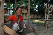 Spinning silk<br /> Mising Tribe (Mishing or Miri Tribe)<br /> Majuli Island, Brahmaputra River<br /> Largest river island in India<br /> Assam,  ne India