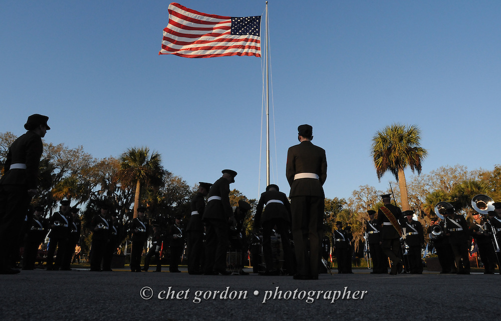 Members of the Parris Island Marine Band muster in formation after the morning flag raising ceremony outside the Commanding General's headquarters at the Marine Corps Recruit Depot (MCRD) in Parris Island, SC on Friday, March 15, 2013.