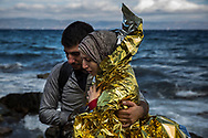 A Syrian couple hugs after its arrival on a dinghy from the Turkish coasts to the northeastern Greek island of Lesbos, on Wednesday, Sept. 30, 2015. The International Organization for Migration says a record number of people have crossed the Mediterranean into Europe this year, now topping a half a million, with some 388,000 entering via Greece.(AP Photo/Santi Palacios)