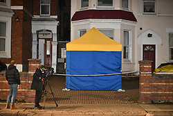 © Licensed to London News Pictures. 21/11/2018. London, UK. The scene at a property in Harlesden, north London after police were called to reports of two suspicious devices found in an unoccupied flat which was in the process of being refurbished. As a precaution, the block of flats was evacuated and local road closures put in place whilst specialist officers assessed the two devices. Initial assessment was that they were both improvised explosive devices (IEDs). They were subsequently made safe and recovered from the flat and are now undergoing further forensic examination. Further searches were also conducted in and around the block of flats and the area has now been deemed safe. Photo credit: Ben Cawthra/LNP