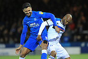 Ryan Tafazolli and Calvin Andrew during the EFL Sky Bet League 1 match between Peterborough United and Rochdale at London Road, Peterborough, England on 12 January 2019.
