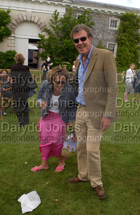 Mr. and Mrs. Jeremy Clarkson, Cartier Style Et Luxe, Goodwood, 27 June 2004. SUPPLIED FOR ONE-TIME USE ONLY-DO NOT ARCHIVE. © Copyright Photograph by Dafydd Jones 66 Stockwell Park Rd. London SW9 0DA Tel 020 7733 0108 www.dafjones.com