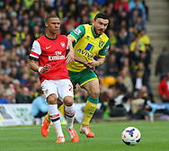 Kieran Gibbs of Arsenal and Robert Snodgrass of Norwich in action during the Barclays Premier League match at Carrow Road, Norwich<br /> Picture by Paul Chesterton/Focus Images Ltd +44 7904 640267<br /> 11/05/2014