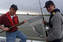 Orford Quay, Suffolk. Nick Roe feature for travel on sea fishing. A package which includes going out fishing for sea bass then eating the results, July 28, 2000. Photo by Andrew Parsons / i-images..