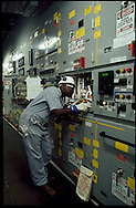 Electrican working in the Power Generation room on a Floating Production Storage and Offloading unit, Angola.