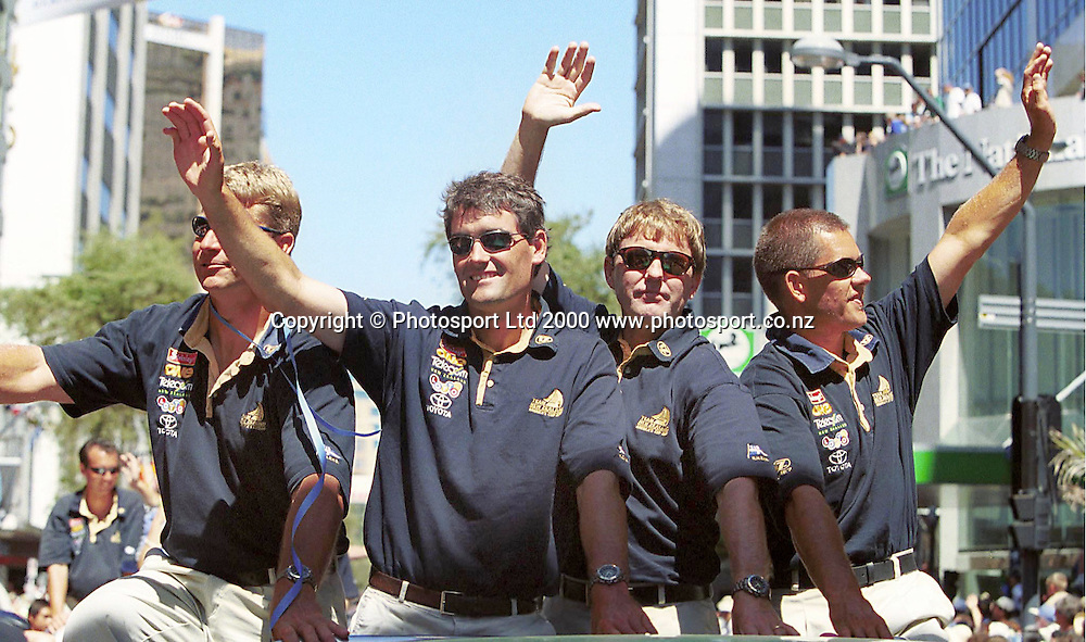 (L to R) Jeremy Scantlebury, Russel Coutts, Paul Murray and Dean Phipps wave to the crowds during the ticker tape parade down Queen Street for Team New Zealand.<br />
