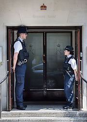 © Licensed to London News Pictures. 21/06/2017. London, UK. A very tall policeman stands with his shorter colleague on duty outside the King Edward VII's hospital in west London where Prince Philip, The Duke of Edinburgh has been admitted to hospital following an an infection. Photo credit: Peter Macdiarmid/LNP