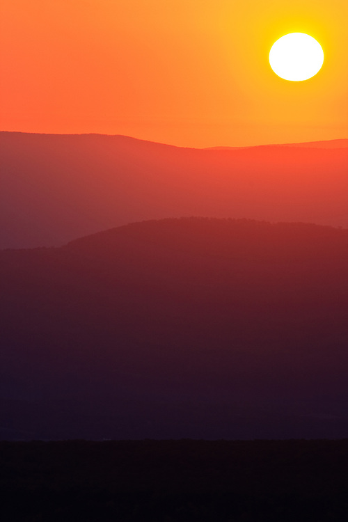 Sunrise over the ridges and valleys east of the Allegheny Front as seen from the ridgeline at Bear Rocks Preserve, Dolly Sods, West Virginia.  Property owned by The Nature Conservancy.
