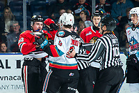 KELOWNA, BC - FEBRUARY 7: Tyson Kozak #18 of the Portland Winterhawks gets in the face of Mark Liwiski #9 of the Kelowna Rockets as line officials Cody Wanner and Dustin Minty break it up at Prospera Place on February 7, 2020 in Kelowna, Canada. (Photo by Marissa Baecker/Shoot the Breeze)