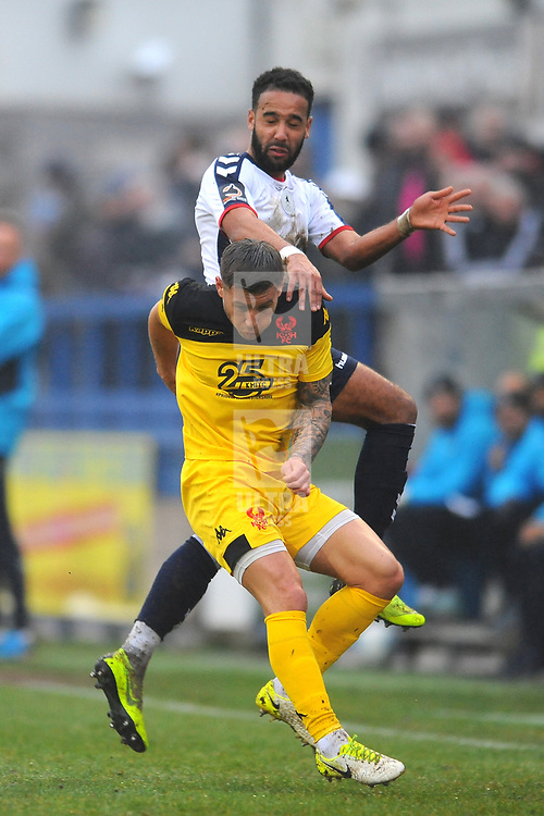 TELFORD COPYRIGHT MIKE SHERIDAN 19/1/2019 - Brendon Daniels of AFC Telford battles for the ball with Lee Vaughan during the Vanarama Conference North fixture between AFC Telford United and Kidderminster Harriers