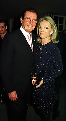 Actor ROGER MOORE and his close friend MRS KIKI THOLSTRUP, at a party in London on 8th November 1999.MYS 5
