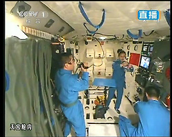 59870556  <br /> This TV grab taken on June 20, 2013 shows female astronaut Wang Yaping (C), one of the three crew members of Shenzhou-10 spacecraft, giving a lecture to students on Earth aboard China s space module Tiangong-1. A special lecture began Thursday morning, given by Wang Yaping aboard China s space module Tiangong-1 to students on Earth, Thursday June 20, 2013.<br /> UK ONLY