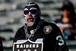 OAKLAND, CA - NOVEMBER 17: An Oakland Raiders fan watches pregame warm ups before the gameagainst the Cincinnati Bengals at RingCentral Coliseum on November 17, 2019 in Oakland, California. The Oakland Raiders defeated the Cincinnati Bengals 17-10. (Photo by Jason O. Watson/Getty Images) *** Local Caption ***