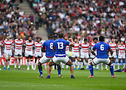 The Samoan Team perform the Manu Siva Tau in front of the Japanese during the Rugby World Cup Pool B match between Samoa and Japan at stadium:mk, Milton Keynes, England on 3 October 2015. Photo by David Charbit.