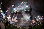 The gigantic overhead television screen shows the pregame festivities on the field as fireworks go off before the Dallas Cowboys NFL week 8 regular season football game against the Washington Redskins on Monday, Oct. 27, 2014 Arlington, Texas. The Redskins won the game 20-17 in overtime. ©Paul Anthony Spinelli