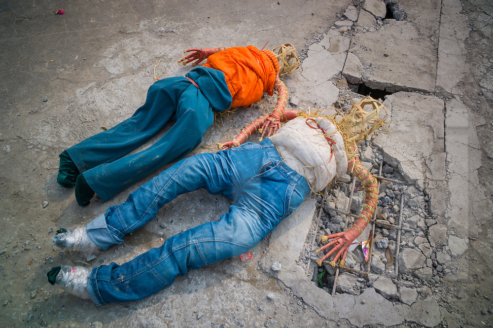 Handmade dummies lying on the ground outside Bui Chu Church, one of the oldest churches in Vietnam (built in 1885) <br /> Xuan Ngoc Commune, Xuan Truong District<br /> , Nam Dinh Province, Vietnam, Southeast Asia