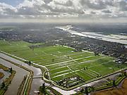 Nederland, Zuid-Holland, gemeente Molenlanden, 25-02-2020; Alblasserwaard,<br /> Alblasserwaard, gebied waterschap Nederwaard.  Molens Kinderdijk in de voorgrond, foto richting Alblasserdam en rivier De Noord.<br /> Kinderdijk windmills in the foreground, photo towards Alblasserdam and river De Noord.<br /> <br /> luchtfoto (toeslag op standard tarieven);<br /> aerial photo (additional fee required)<br /> copyright © 2020 foto/photo Siebe Swart
