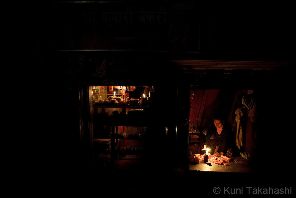 (Jan 4, 2012 - Kathmandu, Nepal).Shops use candle lights during power outage in Kathmandu, Nepal, on Jan 4, 2012. For the last several years, nearly 800,000 people of the capital city faced up to 16 hours of blackouts every day, mainly caused by political instability. Nepal is said to be second only to Brazil in terms of water resources but the government has been incapable of harnessing hydropower..(Photo by Kuni Takahashi)