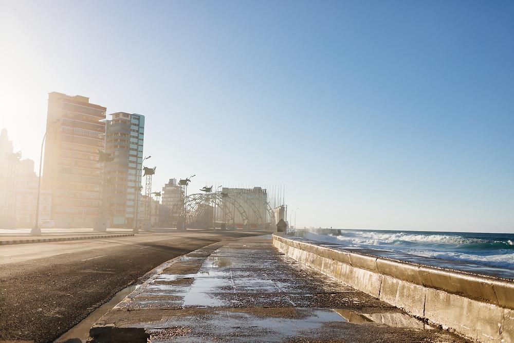 Ocean water crashes against the Malecón in Havana, Cuba