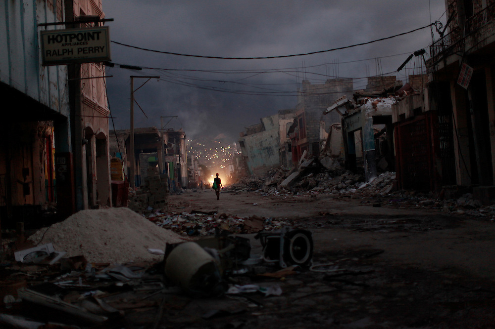 A woman walks amid ruins due to the Jan.12 earthquake in downtown Port-au-Prince, Haiti, Feb. 2,  2010. (AP Photo/Rodrigo Abd)