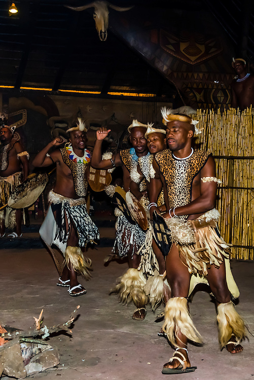 A cultural performance with singing, dancing and music, Lesedi Cultural Village, Broederstroom (near Johannesburg), South Africa. The cultural village includes five traditional homesteads, each inhabited by Zulu, Xhosa, Pedi, Basotho and Ndebele tribes who live according to tribal folklore and traditions of their ancestors.